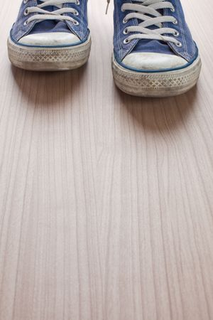 pair of blue sneakers on wooden floor Stock Photo - 6119181
