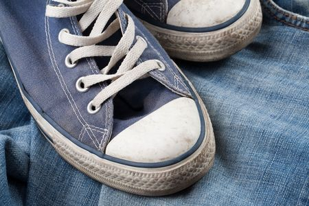 the old sneakers and blue jeans Stock Photo - 6158558