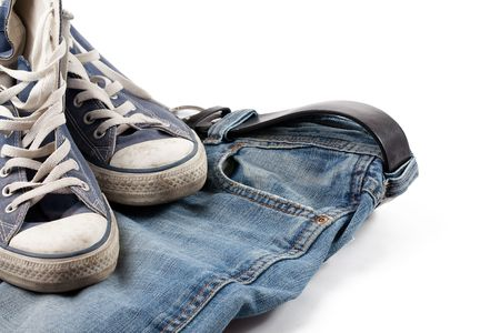 gym shoes: the old sneakers and blue jeans