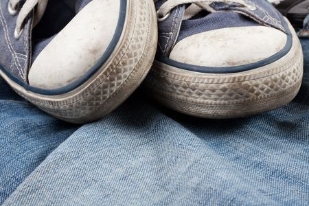 the old sneakers and blue jeans photo