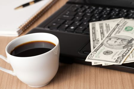 coffee cup and computer with money on desk Stock Photo - 6274208