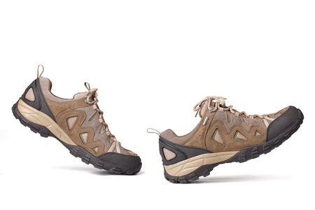 chaussure: les chaussures de randonn�e sur un fond blanc