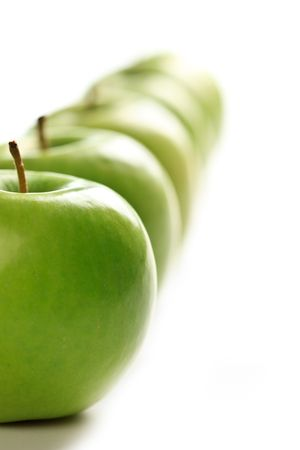 green apples: photo shot of line of green apples Stock Photo