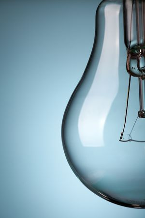 the detail of light bulb on blue background Stock Photo - 6509640