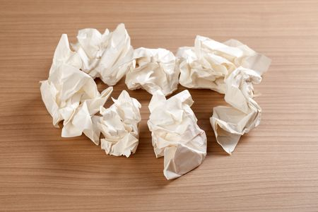 scrunched: photo shot of paper ball on table Stock Photo