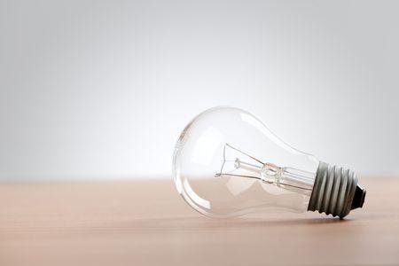 the light bulb on table Stock Photo - 6509637