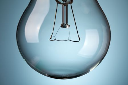 the detail of light bulb on blue background Stock Photo - 6509888