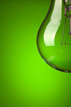 photo shot of detail of light bulb on green background Stock Photo - 6509606