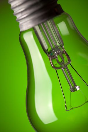 photo shot of detail of light bulb on green background Stock Photo - 6509730