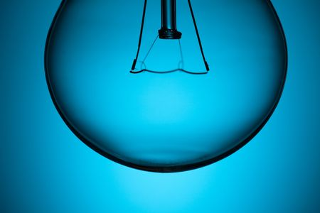 the detail of light bulb on blue background Stock Photo - 6509736