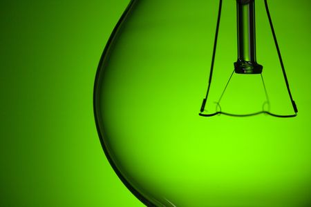 photo shot of detail of light bulb on green background Stock Photo - 6509665