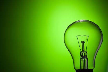 idea lamp: photo shot of light bulb on green background