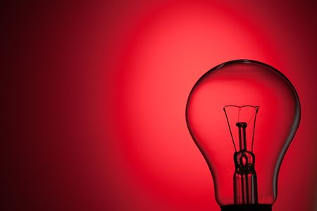 photo shot of light bulb on red background Stock Photo - 6509716