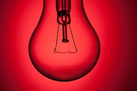 photo shot of light bulb on red background Stock Photo - 6509821