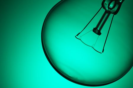 photo shot of detail of light bulb on green background Stock Photo - 6509826
