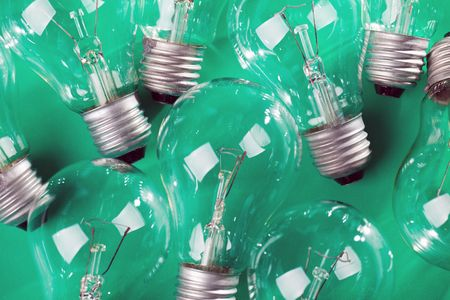 photo shot of light bulb on green background Stock Photo - 6509615