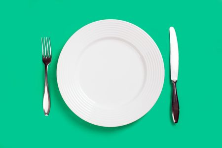plate fork and knife on green background Stock Photo - 6509614