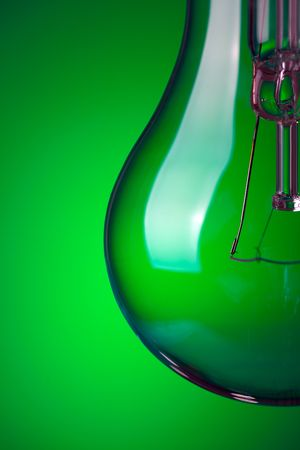 photo shot of detail of light bulb on green background Stock Photo - 6509882