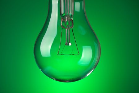 photo shot of detail of light bulb on green background Stock Photo - 6509883