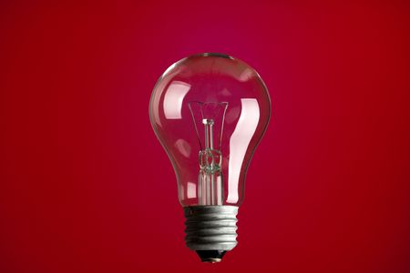 photo shot of light bulb on red background Stock Photo - 6509683