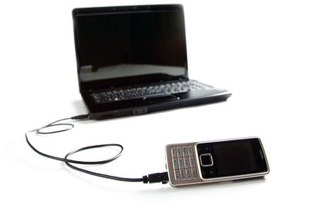 connected cellphone to laptop on white background Stock Photo - 6558689