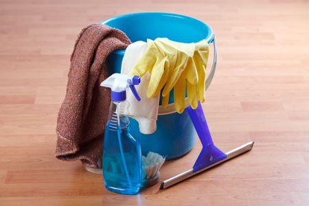 cleaning background: cleaning products on wooden floor Stock Photo