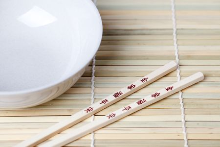 placemats: chopsticks and bowl on bamboo placemats