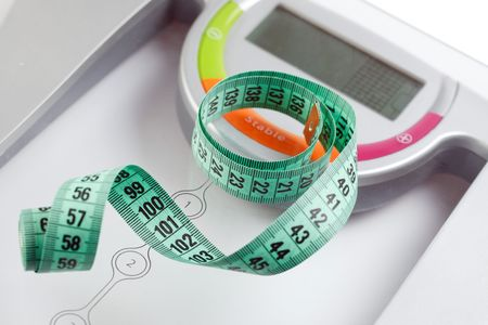 scale and measuring tape on white background Stock Photo - 6583733