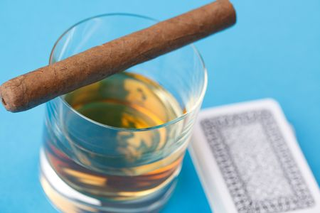 alcohol and cigar on blue background Stock Photo - 6629782