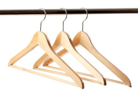 the wooden hanger on white background photo