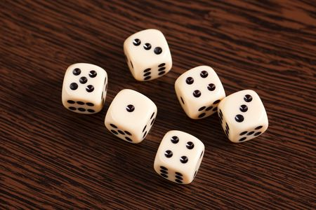 photo shot of dice on wooden table Stock Photo - 6675526