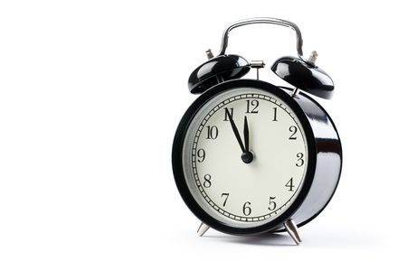 orologi antichi: la sveglia su sfondo bianco  Archivio Fotografico