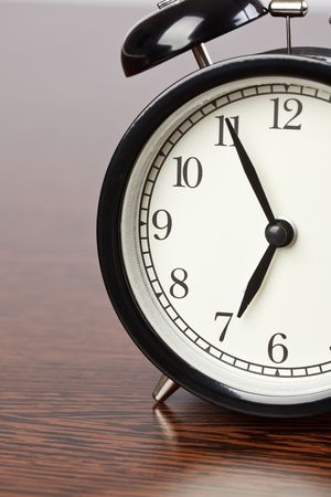 the alarm clock on wooden table photo