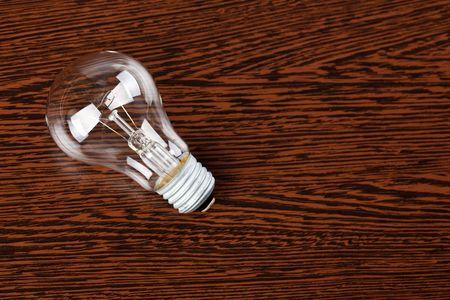 light bulb on wooden table Stock Photo - 6741372