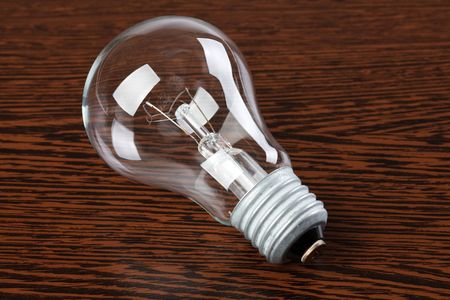 light bulb on wooden table Stock Photo - 6741373
