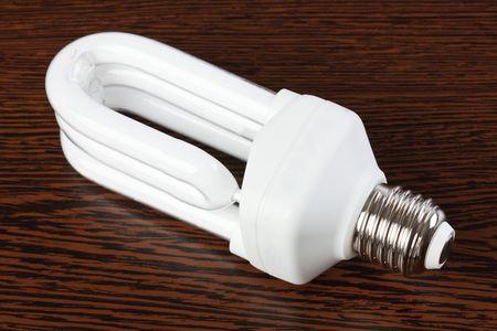 light bulb on wooden table Stock Photo - 6741365