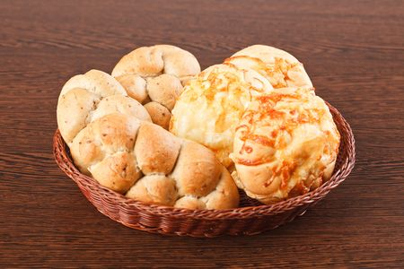 the bread rolls on wooden table photo