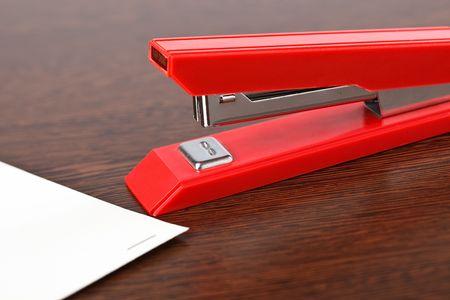 office stapler on wooden table photo