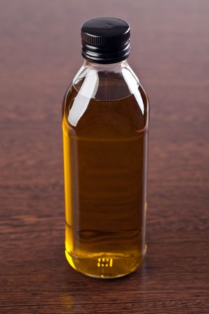 glass of olive oil on wooden table Stock Photo - 6741352