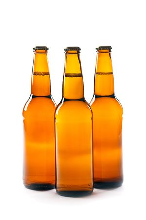 Brown bottle of beer on white background photo