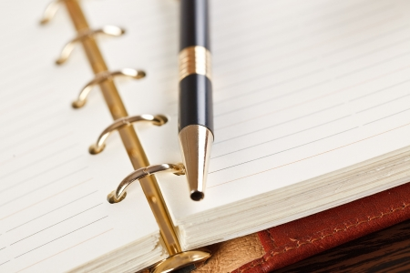 open notebook and pen on table
