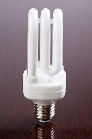 energy saving bulb on wooden table Stock Photo - 6800722