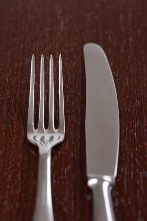 photo shot of cutlery on wooden table photo