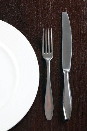 plate and cutlery on wooden table Stock Photo - 6800741