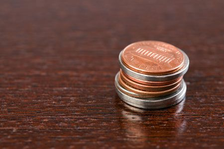 the coins on wooden table photo