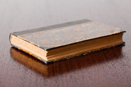 the old book on wooden table photo