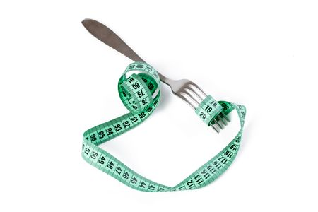 fork with measuring tape on white background photo