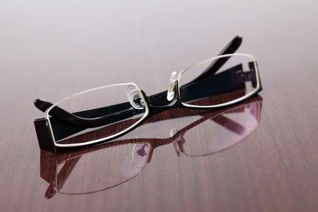 the glasses on wooden table photo