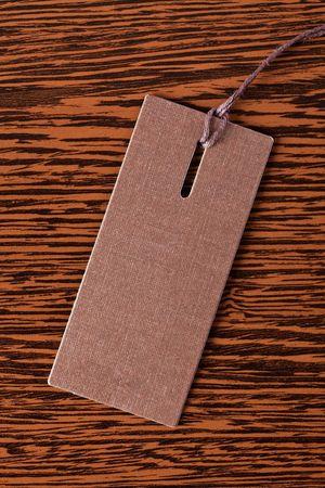 merchandize: price tag on wooden background