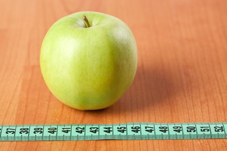 green apple and measuring tape photo